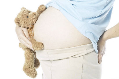 pregnant woman holding teddy bear uid 1285065.jpg