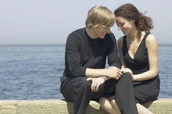 Romantic couple sitting on wooden pier.jpg