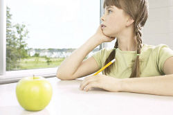 Little girl daydreaming out classroom window.jpg