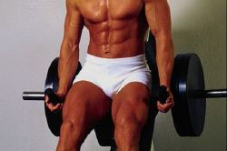 Muscled man sitting on weights.jpg