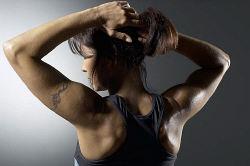 Woman with tattooed arm uid 1283764.jpg