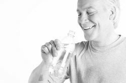 Man drinking bottle of water after workout 2.jpg
