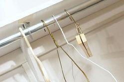 Hangers hanging in empty closet c102114.jpg