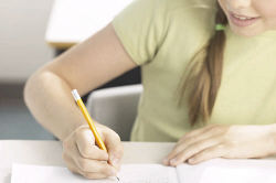 Little girl writing at her desk 8.jpg