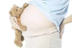 new34_Pregnant woman holding teddy bear uid 1285065.jpg