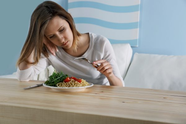 images_2142017_bigstock-Young-depressed-girl-with-eati-134137526-600x400.jpg