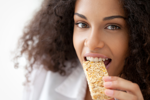 images_2052017_woman-eating-snack-bar.jpg
