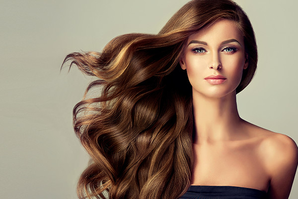 images_2252017_2_Woman-With-Long-Hair-Using-Hair-Extensions-.jpg