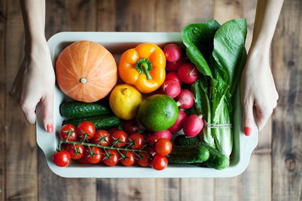 images_552017_womans-hands-holding-dish-full-of-veggies-and-fruits.jpg