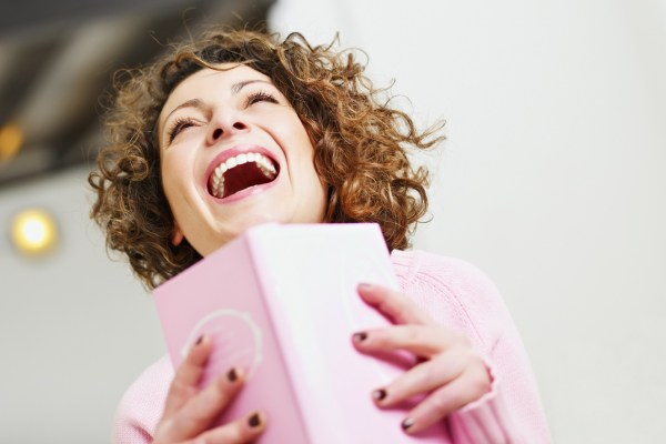images_872017_2_woman_laughing_with_a_book_in_hand.jpg