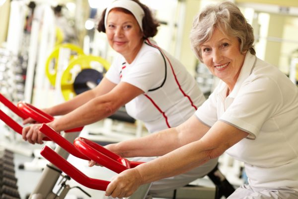images_992017_two-women-at-gym-riding-bikes-600x400.jpg